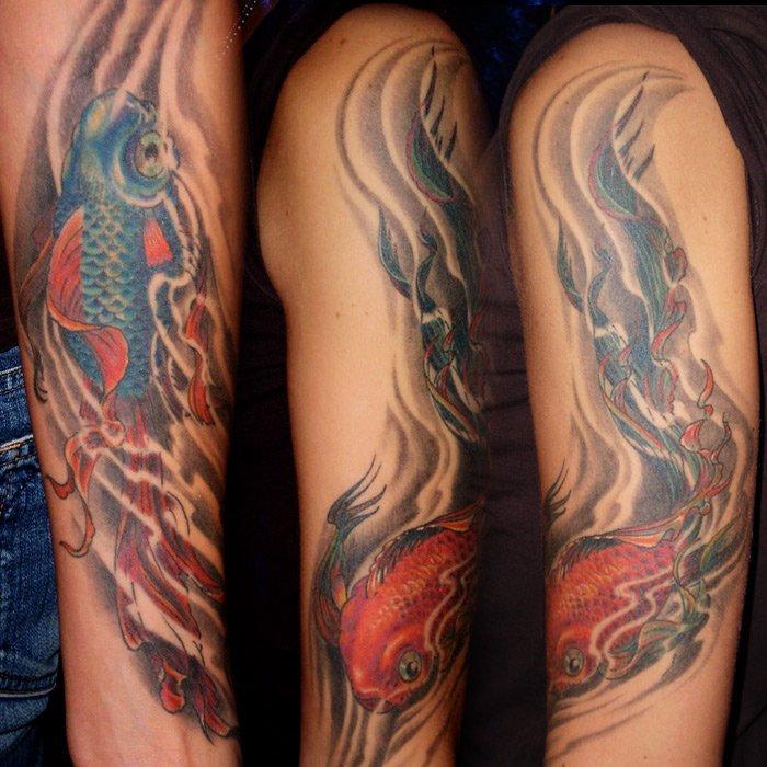 japanisches yin und yang Tattoo in Form von Fischen München